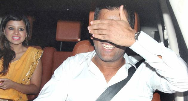 Blinded by the sudden glare of cameras? M S Dhoni seems to shy away from the camera