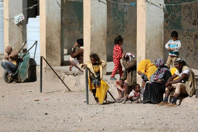 Displaced Yemenis who fled fighting between Huthi rebels and the Saudi-backed government forces stay inside a school building in the town of al-Turba in Taez governerate