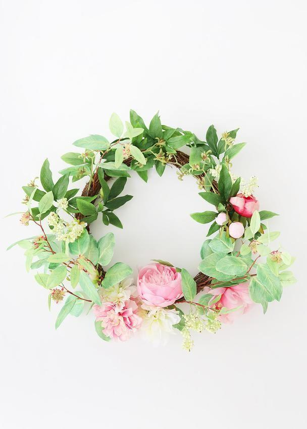 """<p>afloral.com</p><p><strong>$68.00</strong></p><p><a href=""""https://www.afloral.com/products/faux-flowers-pink-peony-and-dahlia-twig-wreath-26"""" rel=""""nofollow noopener"""" target=""""_blank"""" data-ylk=""""slk:Shop Now"""" class=""""link rapid-noclick-resp"""">Shop Now</a></p><p>Cheerful garden roses adorn this playful, romantic wreath from <a href=""""https://www.afloral.com/"""" rel=""""nofollow noopener"""" target=""""_blank"""" data-ylk=""""slk:Afloral."""" class=""""link rapid-noclick-resp"""">Afloral.</a></p>"""