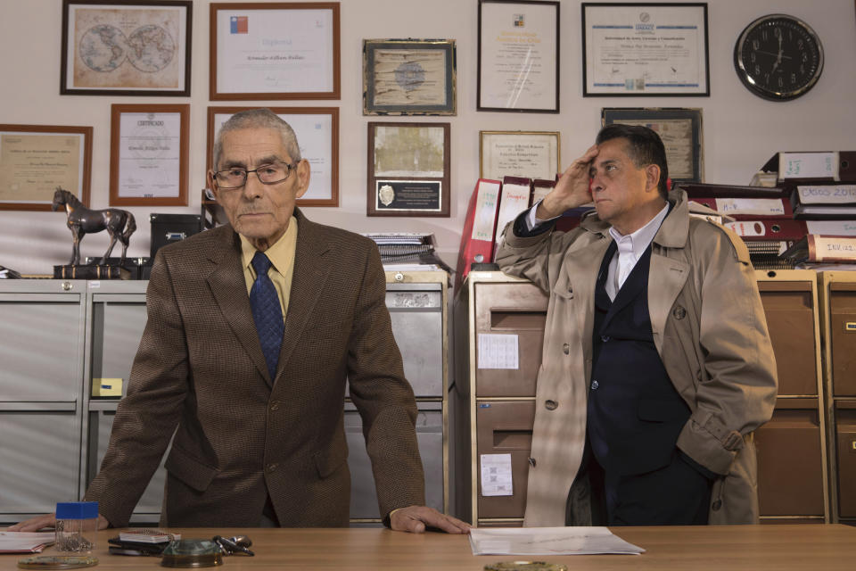 """This image released by Gravitas Ventures shows Romulo Aitken, right, and Sergio Chamy in a scene from """"The Mole Agent."""" (Alvaro Reyes/Gravitas Ventures via AP)"""