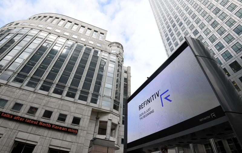 FILE PHOTO: The Refinitiv logo is seen on a large screen in Canary Wharf in London