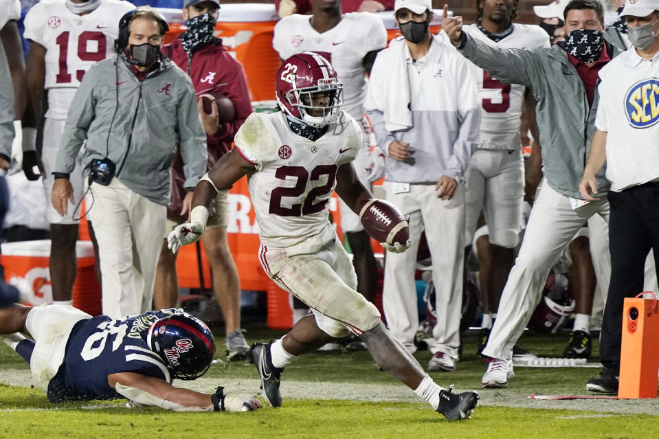 Alabama running back Najee Harris (22) runs past Mississippi linebacker MoMo Sanogo (46) during the second half of an NCAA college football game in Oxford, Miss., Saturday, Oct. 10, 2020. Alabama won 63-48. (AP Photo/Rogelio V. Solis)