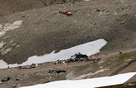 A helicopter is seen above the accident site of a Junkers Ju-52 airplane near Flims