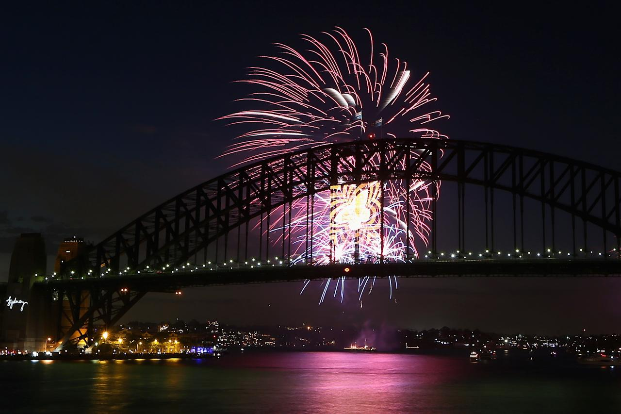 SYDNEY, AUSTRALIA - DECEMBER 31:  Fireworks light up the sky during the nine o'clock show during New Years Eve celebrations on Sydney Harbour on December 31, 2012 in Sydney, Australia.  (Photo by Cameron Spencer/Getty Images)