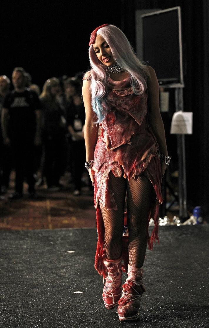 """FILE - In this Sept. 12, 2010 file photo, singer Lady Gaga walks backstage wearing a dress made of meat after accepting the award for video of the year for """"Bad Romance"""" at the MTV Video Music Awards in Los Angeles. The dress has made its way to Washington, along with Loretta Lynn's song about """"The Pill"""" and other relics from music history. Lady Gaga's dress from the 2010 MTV Video Music Awards is being displayed at the National Museum of Women in the Arts with an explanation of her political message. (AP Photo/Matt Sayles, file)"""