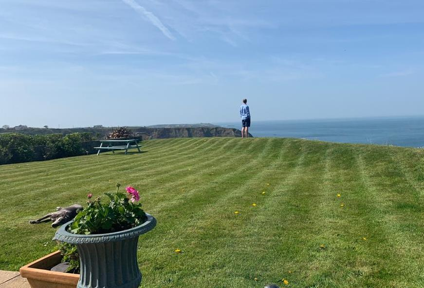Nick Smith (pictured) at the end of his garden in Nefyn, North Wales, before the cliff fall took away 13ft off his property. (Yahoo UK/Courtesy of Nick Smith)