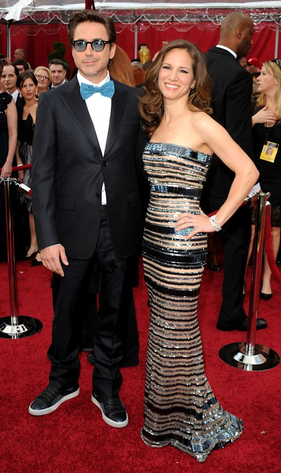 "Robert Downey Jr.   Grade: A    The ""Sherlock Holmes"" star (with wife Susan Downey) was a fan favorite in his outrageous ensemble. Only RDJ could pull off casual kicks and a turquoise bow tie at the Academy Awards!"