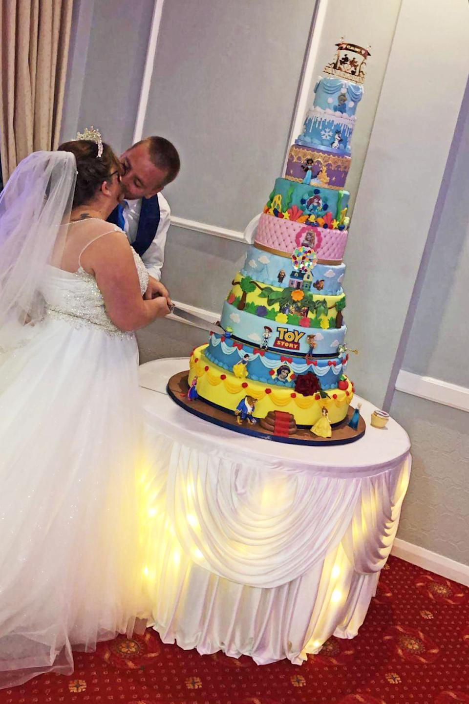 Disney superfans Siobhan Perdue, 24, and Sean, 29, opted for an unconventional wedding cake to match their film favourites theme. [Photo: Caters