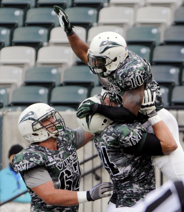 Portland State's DJ Adams (10) celebrates a touchdown run against Weber State with Mitchell VanDyk (64) and Kyle Smith (67) during the first half of an NCAA college football game in Portland, Ore., Saturday Nov 2, 2013. (AP Photo/Greg Wahl-Stephens)