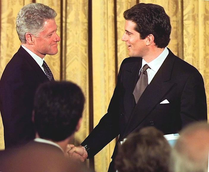 John F Kennedy Jr with President Bill Clinton at the White House in 1998 (AFP via Getty Images)