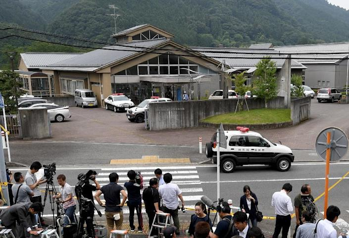 Journalists gather at the main gate of the Tsukui Yamayuri En care centre where a knife-wielding man went on a rampage in Sagamihara, Japan's Kanagawa prefecture, early on July 26, 2016 (AFP Photo/Toshifumi Kitamura)
