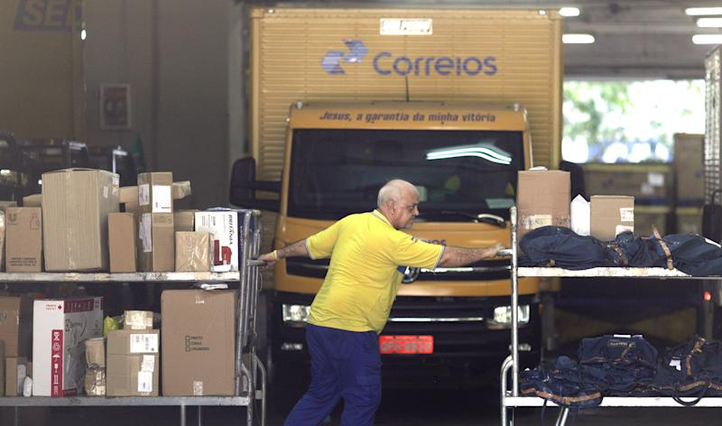 A man works at the national postal office Correios headquarters in Rio de Janeiro, Brazil April 26, 2019. REUTERS/Ricardo Moraes