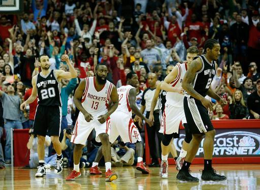 HOUSTON, TX - MARCH 24: James Harden #13 of the Houston Rockets (C) celebrates his game winning shot to defeat the San Antonio Spurs 96-95 at Toyota Center on March 24, 2013 in Houston, Texas. (Photo by Scott Halleran/Getty Images)