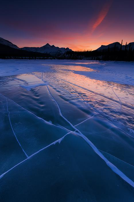 The photographer explained that seeing a frozen lake this spectacular is rare as they are usually covered in a thick blanket of snow.  In this area, however, there is little precipitation which allows for stunning views of the frozen surface and beneath.  (Photo: Emmanuel Coupe)