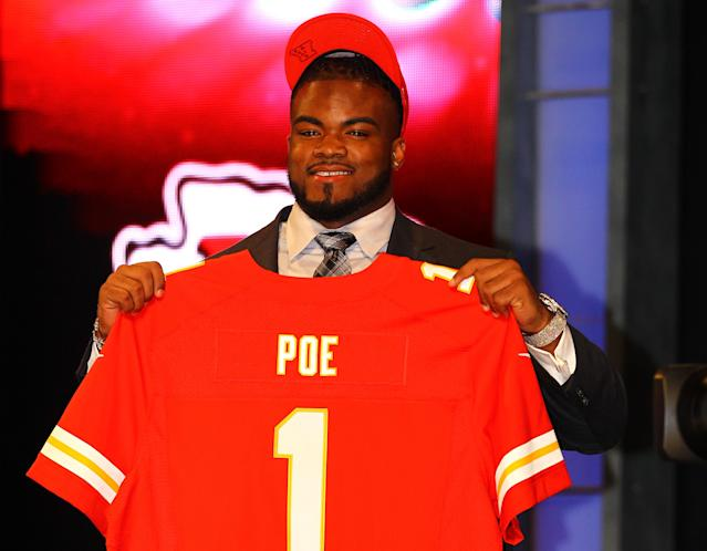 NEW YORK, NY - APRIL 26: Dontari Poe of Memphis holds up a jersey as he stands on stage after he was selected #11 overall by the Kansas City Chiefs in the first round of the 2012 NFL Draft at Radio City Music Hall on April 26, 2012 in New York City. (Photo by Al Bello/Getty Images)