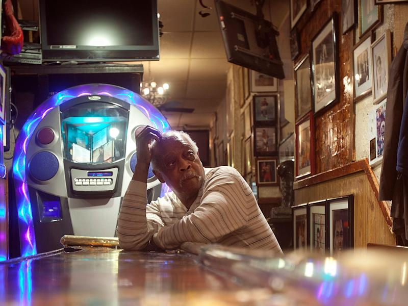 Owner and Boxing Hall of Fame trainer Jimmy Glenn sits at the bar of his famous Times Square bar Jimmy's Corner in 2014.