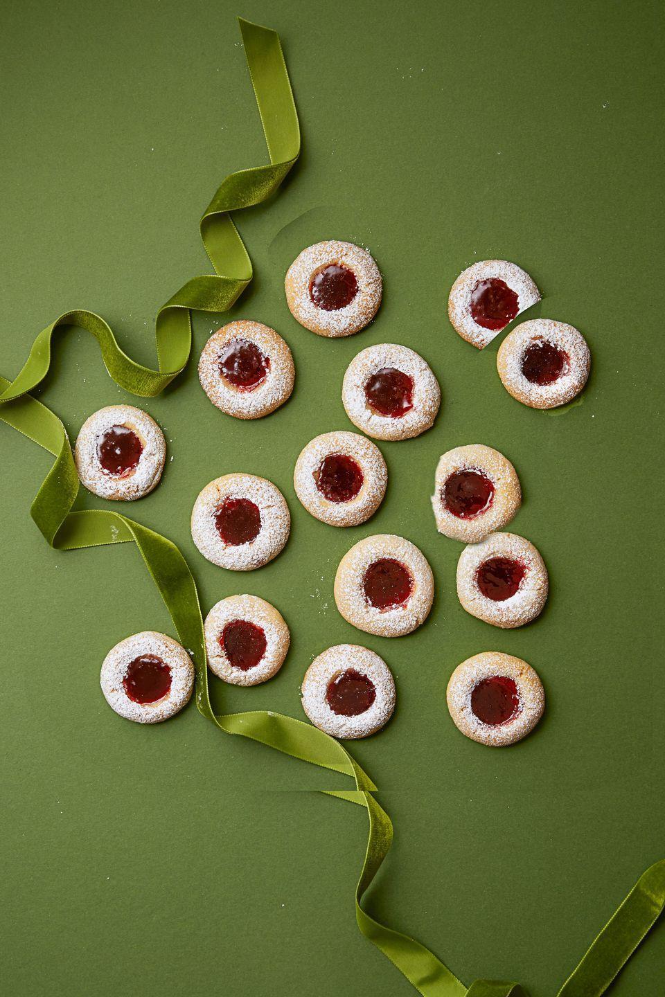 """<p>These Swedish cookies are called <em>Hallongrotta</em>, meaning """"raspberry cave"""". We added a little honey for extra sweetness.</p><p><em><a href=""""https://www.goodhousekeeping.com/food-recipes/dessert/a35760/razzy-jammy-thumbprints/"""" rel=""""nofollow noopener"""" target=""""_blank"""" data-ylk=""""slk:Get the recipe for Raspberry Jam Thumbprints »"""" class=""""link rapid-noclick-resp"""">Get the recipe for Raspberry Jam Thumbprints »</a></em></p>"""