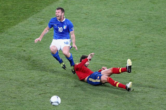 KIEV, UKRAINE - JULY 01: Antonio Cassano (L) of Italy is challenged by Gerard Pique of Spain during the UEFA EURO 2012 final match between Spain and Italy at the Olympic Stadium on July 1, 2012 in Kiev, Ukraine. (Photo by Michael Steele/Getty Images)