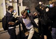 A Trump supporter tries to run from demonstrators at Black Lives Matter plaza across from the White House on Election Day