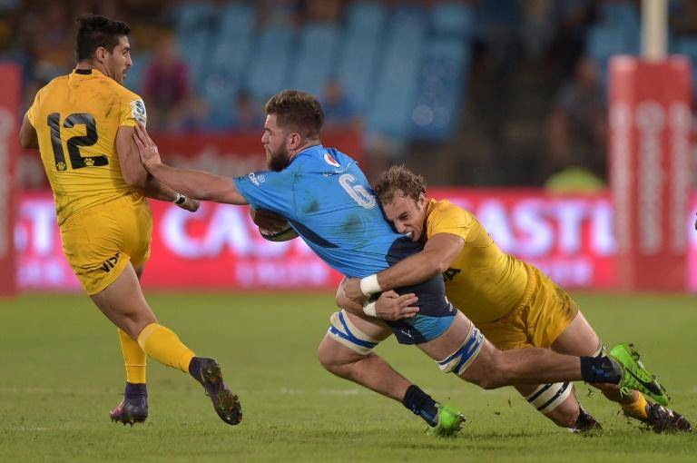 Nick de Jager of the Bulls (L) is tackled by Emiliano Boffelli of the Jaguares during the Super XV rugby match between South African Bulls and Argentinian Jaguares April 15, 2017 in Pretoria
