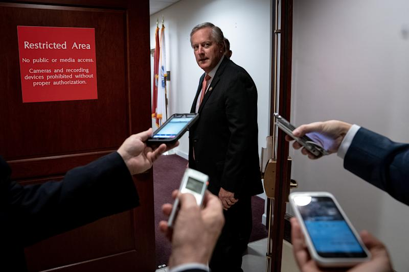 Rep. Mark Meadows (R-N.C.) talks with reporters from the doorway of the secure are where impeachment investigation interviews are taking place on Capitol Hill in Washington on Wednesday, Oct. 23, 2019. (Erin Schaff/The New York Times)