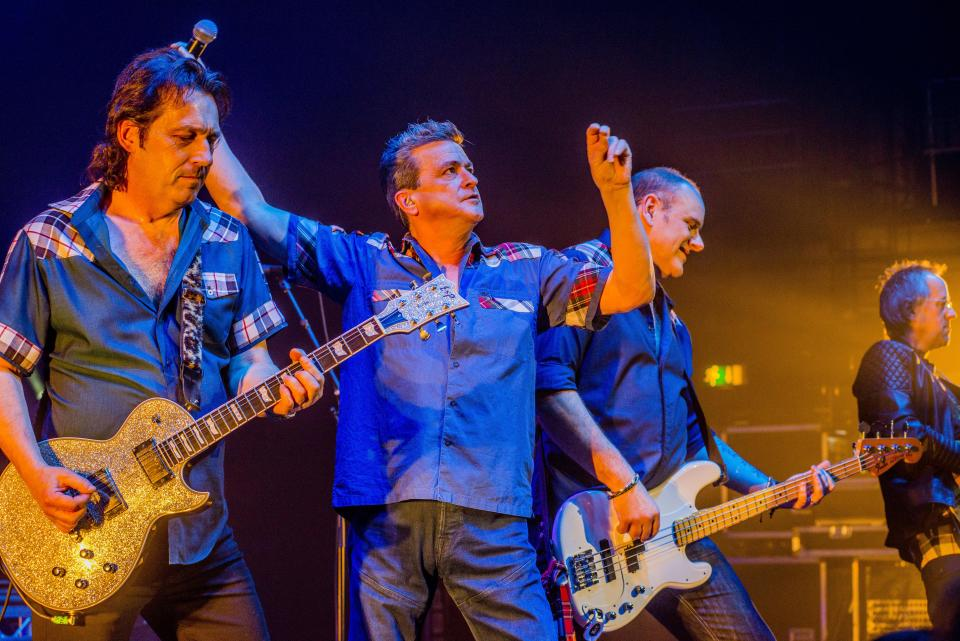 Phil Hendriks (left) and Les McKeown (centre) of the Bay City Rollers perform on stage at the Eventim Apollo, Hammersmith, London, 14th December 2016. (Photo by Dick Barnatt/Redferns)
