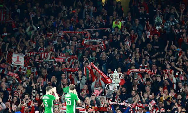Lincoln City fans acknowledge their players as their famous FA Cup run in 2017 comes to an end against Arsenal.