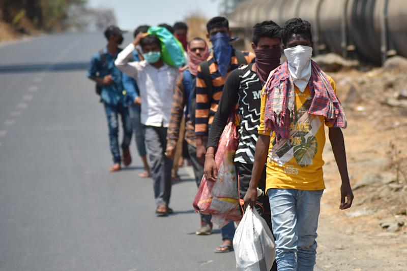 Migrant workers with their belongings walk towards their native places in a scorching heat on Nasik Highway after getting stuck for 40 days during a nationwide lockdown.Indian Prime Minister, Narendra Modi has announced the extension of the lockdown till 17 may across the country restricting the movement of people to curb the spread of the coronavirus. More than 40206 tested positive for corona virus in India with 1323 deaths. (Photo by Sandeep Rasal/SOPA Images/LightRocket via Getty Images)