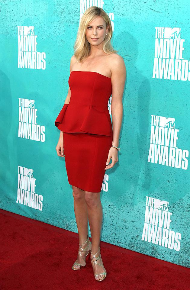 "Charlize Theron also loves her some Lanvin. The Oscar winner -- who appeared at the MTV Movie Awards to promote both <a target=""_blank"" href=""http://movies.yahoo.com/movie/snow-white-and-the-huntsman/"">""Snow White and the Huntsman""</a> and <a target=""_blank"" href=""http://movies.yahoo.com/movie/prometheus-2012/"">""Prometheus""</a> -- turned heads when she arrived at the star-studded soiree in this strapless, peplum-enhanced dress, Cartier bracelet, and metallic Jimmy Choo heels. (6/3/2012)"