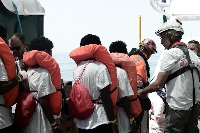 Some rescued migrants were transferred from the NGO-chartered ship Aquarius to an Italian coastguard vessel (AFP Photo/Karpov)