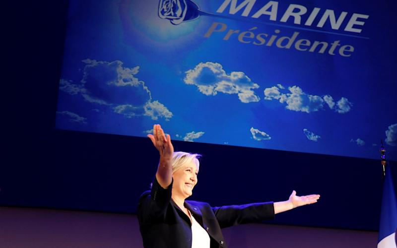 Marine Le Pen, French National Front political party leader and candidate for French 2017 presidential election celebrates - REUTERS