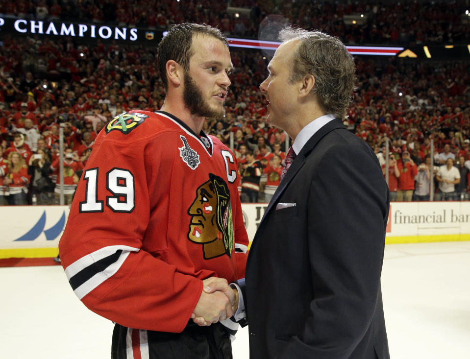 FILE - In this June 15, 2015, file photo, Tampa Bay Lightning head coach Jon Cooper, right, congratulates Chicago Blackhawks center Jonathan Toews (19) after Game 6 of the NHL hockey Stanley Cup Final series in Chicago. No team has won the Stanley Cup on home ice since the Blackhawks in 2015. The Lightning have that chance in Game 5 of the final on Wednesday, July 7, 2021, against the Montreal Canadiens. (AP Photo/Nam Y. Huh, File)