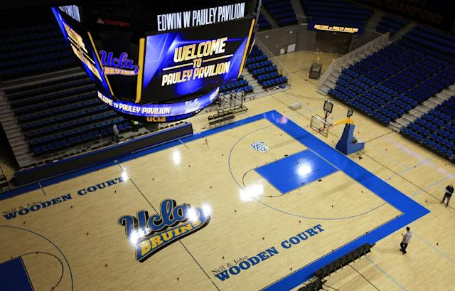 In this photo taken Tuesday, Oct. 23, 2012, an overhead view of the court at Pauley Pavilion at the the University of California in Los Angeles. The UCLA Bruins honor their championship past and address the future in the $132 million renovation to be unveiled on Nov. 9 when they host Indiana State in their men's basketball season opener. (AP Photo/Damian Dovarganes)