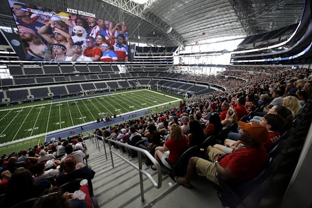 Fans at AT&T stadium watch live coverage on the large video screen of the U.S. Belgium World Cup soccer match, Tuesday, July 1, 2014, in Arlington, Texas. (AP Photo/Tony Gutierrez)