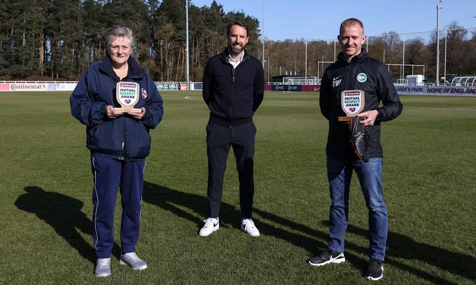 Gareth Southgate with the Nationwide Mutual Respect award winners Tina Jacobs and Dan Weston at St George's Park on Tuesday