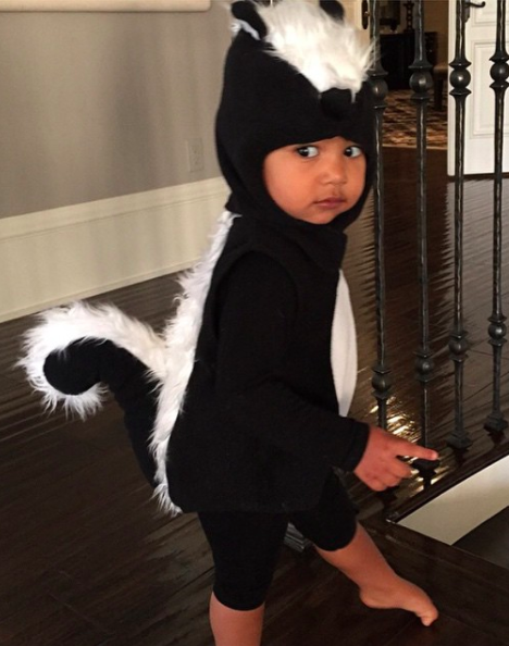 <p>We challenge you to find a costume more adorable. Kim dressed daughter North in a skunk onesie back in 2014 and she couldn't have looked any sweeter. <em>[Photo: Instagram]</em> </p>