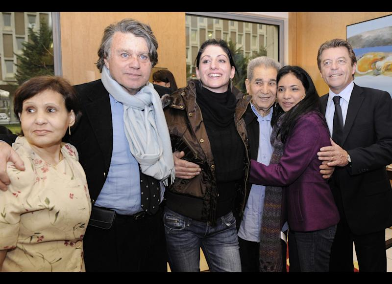 French former prisoners Celine Faye (3rdL) and Sarah Zaknoun (2ndR) pose with Sarah's parents, her mother Khedidja (L) and her father Belkacem (3rdR) as they arrive on December 30, 2009 at the Roissy Charles de Gaulle airport accompanied by French junior minister for Cooperation and Francophonie, Alain Joyandet (R) and their lawyer Gilbert Collard a day after their release from the prison in Santo Domingo. The two French women walked free from jail in the Dominican Republic yesterday thanks to a presidential pardon after 18 months behind bars for drug smuggling. Sarah Zaknoun, 19, and Celine Faye, 20, who had been sentenced to eight years in jail last year after being found with six kilograms (13 pounds) of cocaine in their luggage, spoke by telephone with French President Nicolas Sarkozy after being released following a Christmas pardon. AFP PHOTO POOL BERTRAND GUAY (Photo credit should read BERTRAND GUAY/AFP/Getty Images)