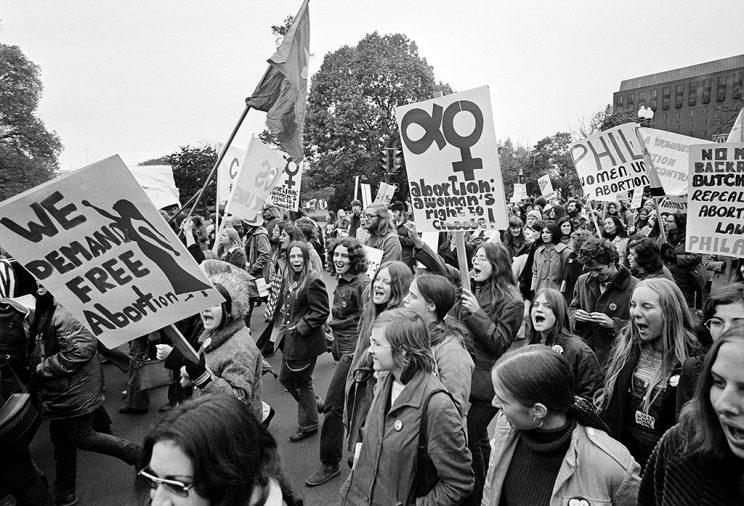 Demonstrators demanding a woman's right to choose march to the U.S. Capitol for a rally seeking repeal of all anti-abortion laws in Washington, D.C., Nov. 20, 1971. On the other side of the Capitol was a demonstration held by those who are against abortion. (Credit: AP Photo)