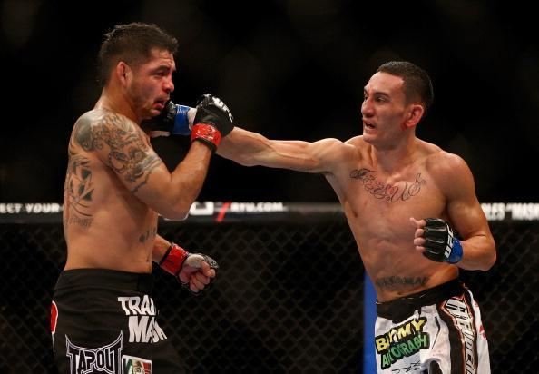 LAS VEGAS, NV - DECEMBER 29: (L-R) Leonard Garcia versus Max Holloway during their featherweight fight at UFC 155 on December 29, 2012 at MGM Grand Garden Arena in Las Vegas, Nevada. (Photo by Donald Miralle/Zuffa LLC/Zuffa LLC via Getty Images)
