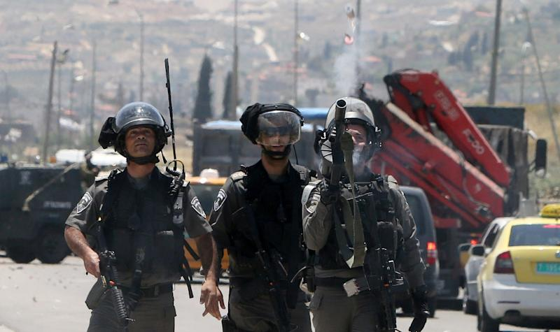 """Israeli security forces fire tear gas towards Palestinian protesters during clashes following a rally to mark the 67th anniversary of the """"Nakba"""" on May 16, 2015 next to Huwarra checkpoint, south of the West Bank city of Nablus"""