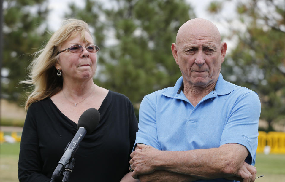 Lonnie and Sandy Phillips, whose daughter Jessica Ghawi was killed in the 2012 Aurora movie theatre attack, speak with members of the media on the day of the reading of the verdict in penalty phase 2 of the James Holmes trial at the Arapahoe County District Court in Centennial, Colo., Monday, Aug. 3, 2015. Jurors declined to rule out the death penalty Monday as they now move toward sentencing Holmes. The decision clears the way for one last attempt from both sides to sway the jury with gripping testimony from victims about their harm and suffering as well as the defense's appeals to show mercy. (AP Photo/Brennan Linsley)
