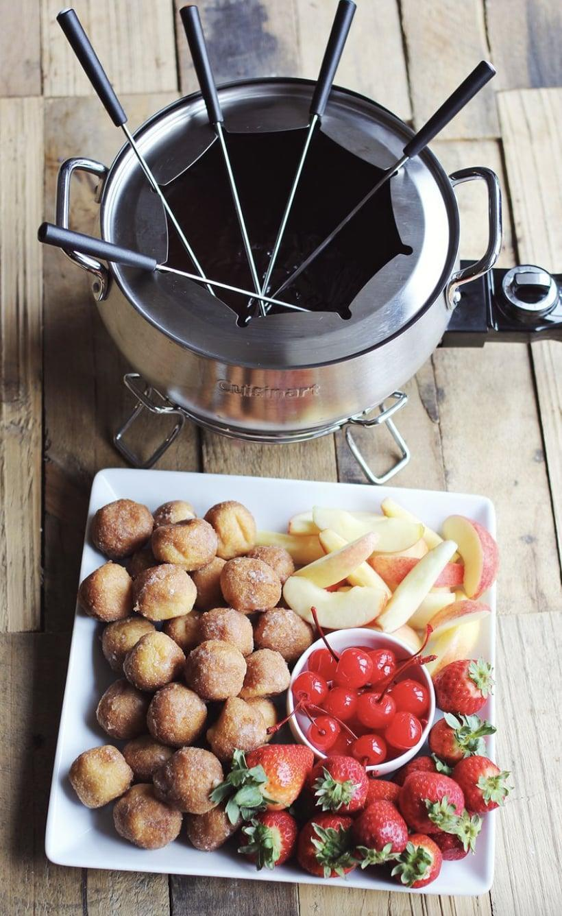 "<p>This four-ingredient recipe is about to make its way onto your favorite dessert list. With chocolate, heavy cream, and cherry liqueur, you can whip up this delicious recipe in no time. We suggest getting berriers, donut holes, or sweet apples to pair it with.</p> <p><strong>Get the recipe</strong>: <a href=""https://abeautifulmess.com/chocolate-cherry-fondue/"" class=""link rapid-noclick-resp"" rel=""nofollow noopener"" target=""_blank"" data-ylk=""slk:chocolate and cherry fondue"">chocolate and cherry fondue</a></p>"
