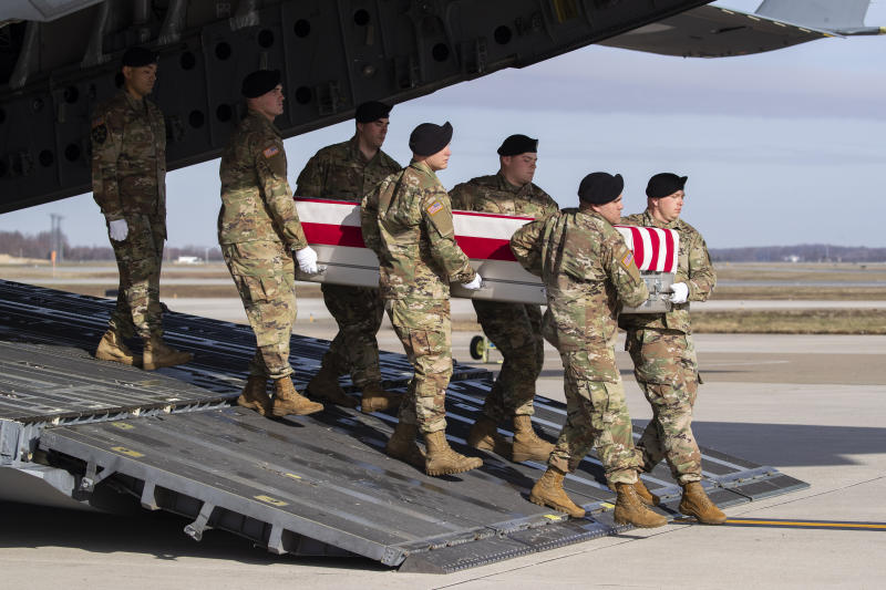 FILE - In this Dec. 25, 2019, file photo, an Army carry team moves a transfer case containing the remains of U.S. Army Sgt. 1st Class Michael Goble, at Dover Air Force Base, Del.. Goble, a U.S. Special Forces soldier who died in Afghanistan this week, was seizing a Taliban weapons cache when he was killed, the U.S. military said Friday. (AP Photo/Alex Brandon, File)