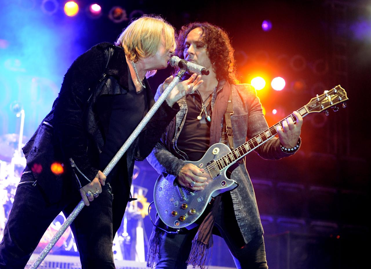 "LOS ANGELES, CA - JUNE 08:  Singer Joe Elliott (L) and musician Vivian Campbell of Def Leppard perform at the after party for the premiere of Warner Bros. Pictures' ""Rock Of Ages"" at Hollywood and Highland on June 8, 2012 in Los Angeles, California.  (Photo by Kevin Winter/Getty Images)"