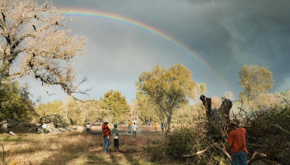 Once the rain stops, a rainbow forms over the property in Mariposa, California, as volunteers finish up the first day of work. (Photo: Ed Kashi/VII)