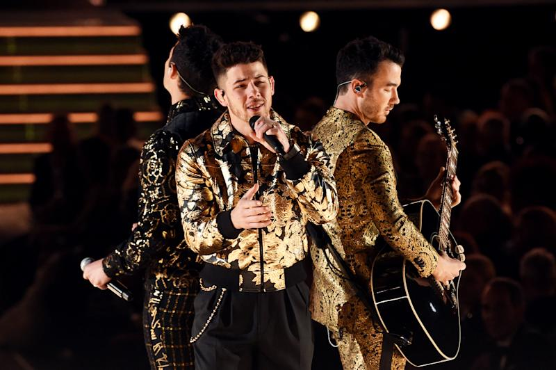 LOS ANGELES, CALIFORNIA - JANUARY 26: (L-R) Joe Jonas, Nick Jonas, and Kevin Jonas of music group Jonas Brothers perform onstage during the 62nd Annual GRAMMY Awards at STAPLES Center on January 26, 2020 in Los Angeles, California. (Photo by Kevin Winter/Getty Images for The Recording Academy )