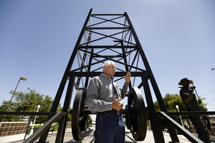 """Dave Noerr, mayor of Taft, Calif., stands in front of the Taft Oilworker Monument. """"It's been a rough couple of months,"""" says Noerr, who is pivoting to get his town's economy running again after the coronavirus lockdown. <span class=""""copyright"""">(Carolyn Cole / Los Angeles Times)</span>"""