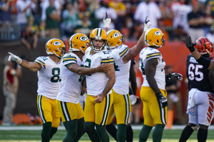 Green Bay Packers kicker Mason Crosby (2) celebrates after a winning field goal during overtime in an NFL football game against the Cincinnati Bengals in Cincinnati, Sunday, Oct. 10, 2021. The Packers defeated the Bengals 25-22 in overtime. (AP Photo/Bryan Woolston)