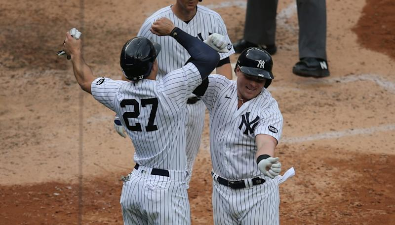 Luke Voit and Aaron judge celebrate after Voit's homer