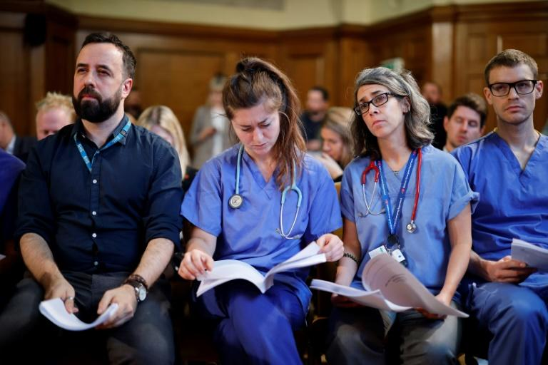 With some 1.7 million staff, Britain's NHS, which is often criticised but fiercely defended, is one of the world's largest employers (AFP Photo/Tolga Akmen)